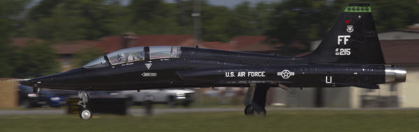 A T-38 Talon streaks down the runway during takeoff for a training mission with F-22 Raptors at Langley Air Force Base on Wednesday.