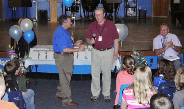 Boonsboro Middle School Principal Paul Engle, left, accepts 240 thesauruses from Keedysville Ruritan member Art Williamson.