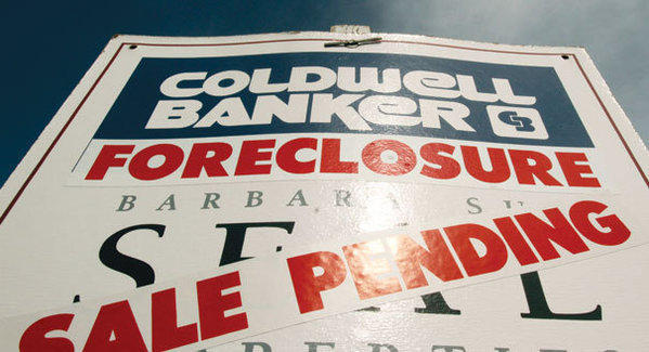 Foreclosures are up from last quarter but down from last year, according to RealtyTrac.