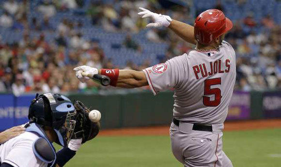 Albert Pujols fouls off a pitch in the first inning.