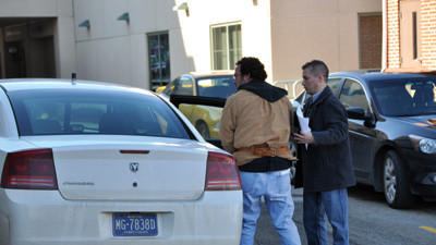 Conemaugh Township Detective Michael Popma escorts Albert Earl Anderson Jr. into the Somerset County Jail in January.