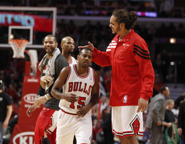 Chicago Bulls center Joakim Noah (13) affectionately hits Chicago Bulls point guard John Lucas (15) on his head Late in the second half of their game against the Memphis Grizzlies at the United center, in Chicago, on Sunday, January 1, 2012. (Nuccio DiNuzzo/ Chicago Tribune)