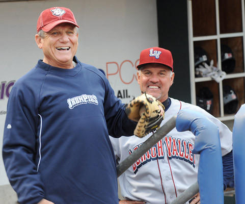 Former Philadelphia Phillies' player and manager Larry Bowa left, along with Lehigh Valley IronPigs' Manager Ryne Sandberg joke around prior to the start of the game at Coca-Cola Park in Allentown Thursday night.