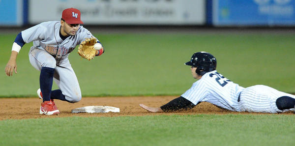 Scranton Wilkes-Barre Yankees' Steve Pearce (25) right, slides safely into second base ahead of the tag from Lehigh Valley IronPigs' Andres Blanco (5) left, Thursday night at Coca-Cola Park in Allentown.