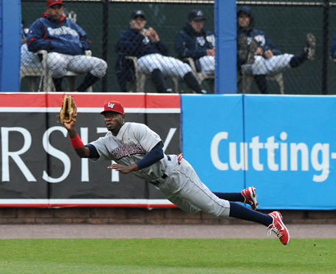 Lehigh Valley IronPigs' outfielder Domonic Brown (9) makes a diving catch in left field in the bottom of the first inning against the Scranton Wilkes-Barre Yankees Thursday night at Coca-Cola Park in Allentown.