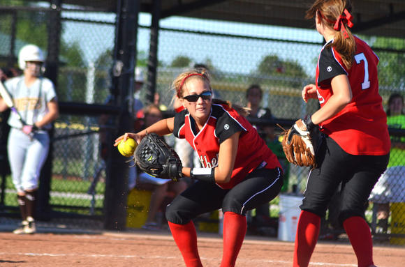 Great Bend's Stephanie Morrison fields a bunt in Thursday's game against Garden City. Morrison reached base six times with five hits in the sweep. Also pictured: Great Bend pitcher Braylin Bretz.