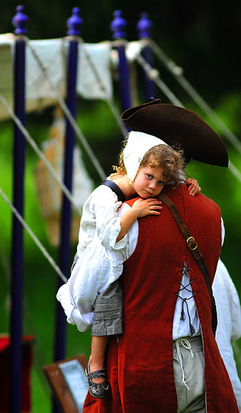 Sophie Roethlisberger, 4, gets a ride Thursday from her dad, Eric Roethlisberger, at Market Fair in Fort Frederick State Park. Roethlisberger portrays a 1750s land speculator traveling with his family. They are from Blacksburg, Va.