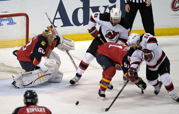 New Jersey Devils Stephen Gionta scores a goal on Florida Panthers goalie Jose Theodore during the second period of their playoff game against the New Jersey Devils.