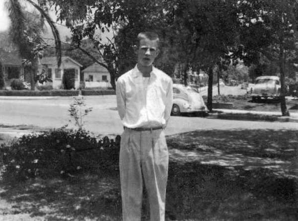 Ron Magneson stands in his familys front yard on Walnut Drive. In the background is Eleanore DrIve, which originally connected to Walnut. Photo, June 1958.