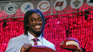 There was no mistaking Robert Griffin III at the NFL draft. The ends of his dreadlocks settled onto a baby blue jacket. His checkered-patterned shirt was offset and a purplish tie with horizontal stripes.