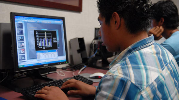 Ernesto Corona, 14, designs a graph during an Asthma Awareness Team meeting Thursday afternoon in Brawley.