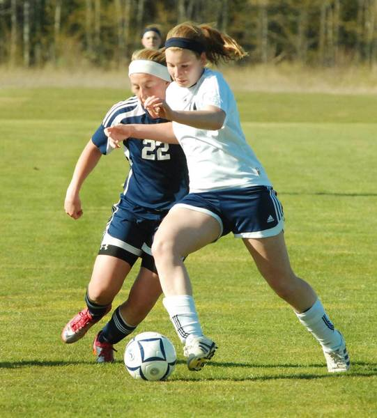 Alyssa VanWerden (right) of Petoskey battles Mackenzie Hurlburt of Cadillac Thursday during a Big North Conference match. The Northmen won, 5-1.