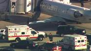 Ambulances pull up to Delta plane at Midway.