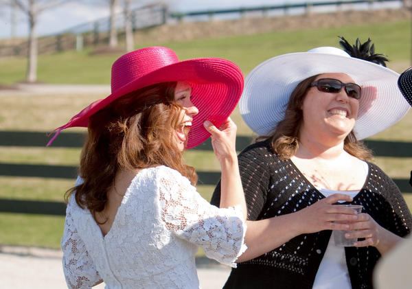 Participants at the 2011 Kentucky Derby Party Fundraiser at the Bay Harbor Equestrian Center, share a laugh while enjoying food, mint juleps and horse racing.