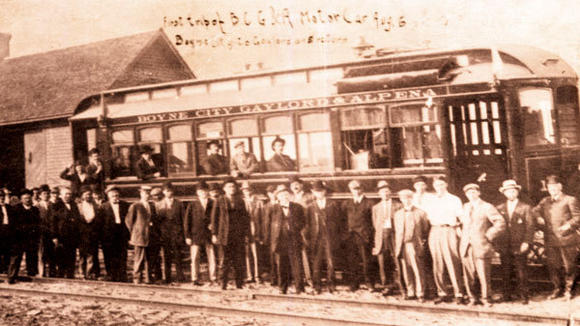 A group of passengers on the first train trip of the Boyne City, Gaylord and Alpena Railroad. The line between the three towns was completed in the early 1900s.