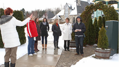 Representatives from Pure Michigan take a tour of Castle Farms during a visit in January.