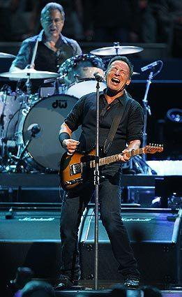 Bruce Springsteen and the E Street Band powered through 26 songs Thursday night at the Los Angeles  Memorial Sports Arena. Behind Springsteen is drummer Max Weinberg.
