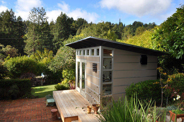 """Studio Shed bills its design as """"a turnkey studio for your backyard,"""" with standard features such as corrugated steel roof, clerestory windows, glass door, lighting and denim-insulated walls finished in your choice of painted drywall or birch paneling. The 10-by-12-foot Lifestyle model pictured here, installed in Northern California, starts at $10,750, plus shipping (starts at $750) and installation (starts at $1,200 for a certified pro)."""