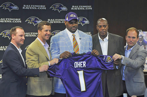 "The Ravens introduce first-round draft pick Michael Oher (center) Sunday in Owings Mills. ""I got every tool I need to be a starter,"" said Oher, who will compete with Willie Anderson for the right tackle job."