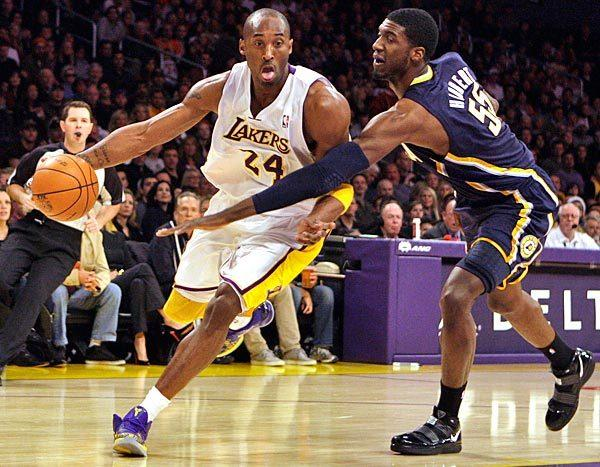 Kobe Bryant blows past Pacers center Roy Hibbert on a drive to the basket during a game at Staples Center.