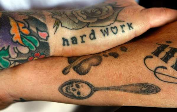 Chef Michael Voltaggio of Ink restaurant displays his tattoos.