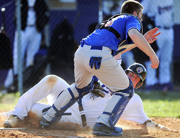 Boonsboro catcher Dustin Gregory, front, tags out Smithsburg's Kyle Dinterman at home plate during Friday's MVAL Antietam baseball game.