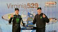 By the thinnest of margins, in a breathtaking finish that featured two cars sideways and side-by-side at the finish line, Kurt Busch beat Denny Hamlin to the checkered flag by .062 seconds to win Friday night's Virginia 529 College Savings 250 at Richmond International Raceway.