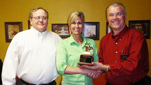 Stacey Bebo, center, of television station KSFY recently received the YAAAAA! Award from the Aberdeen Ambassadors group. To her left is Carl Perry and, to the right, Bernie Harrington.