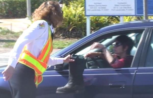 Broward Sheriff Fire Rescue Lt. Pam Mueller collects for Muscular Dystrophy Association.