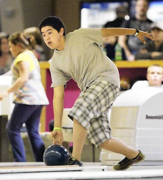 The South Dakota USBC Youth Bowling Tournament wraps up today and Sunday at the Village Bowl in Aberdeen. Pierres Treyton Bad Warrior is pictured bowling in the second week of competition. American News Photo by John Davis