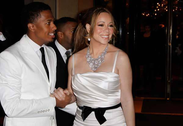 Mariah Carey and her husband Nick Cannon leave the hotel to have a dinner at the Eiffel Tower on April 27, 2012 in Paris, to celebrate their four year wedding anniversary.