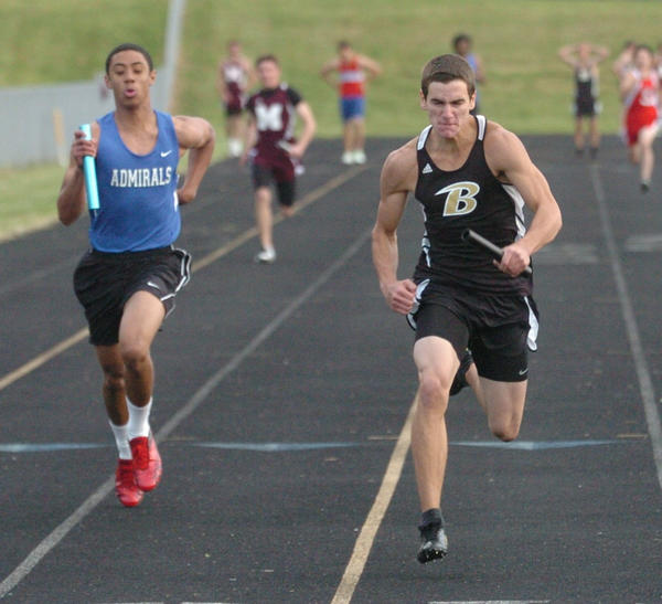 Boyle Countys Cody Coffey edged Danvilles Jawan Grey to win the 400-meter relay Friday, one of three relay wins for the Rebels, who edged Danville 109-108.5.