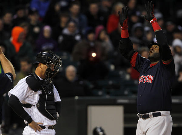 Red Sox's David Ortiz celebrates his two-run home run in the second inning in front of catcher A.J. Pierzynski.