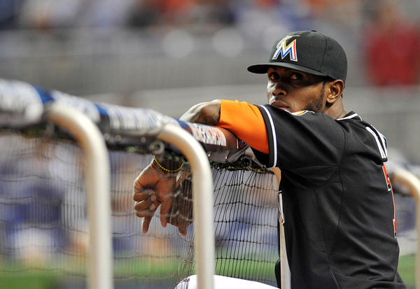 Marlins shortstop Jose Reyes looks on from the dugout.