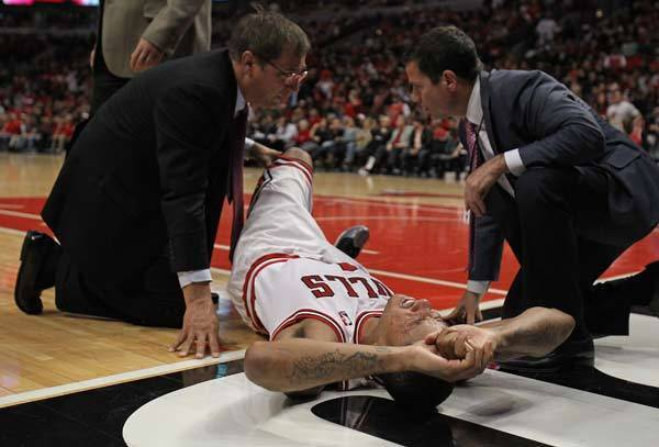 Derrick Rose (1) of the Chicago Bulls is examined after suffering an injury against the Philadelphia 76ers in Game One of the Eastern Conference Quarterfinals during the 2012 NBA Playoffs at the United Center.