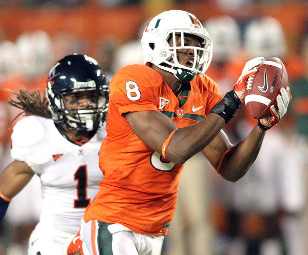 Miami wide receiver Tommy Streeter catches a pass past Virginia cornerback Demetrious Nicholson.