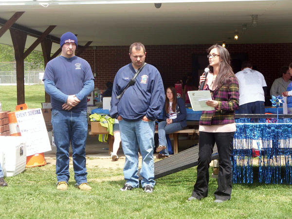 Jordan Appel recognizes Troy Crone, left, and Danny Shirley of the Hancock Fire Department on Saturday at the Walk to End Child Abuse in Hancock. Crone and Shirley responded to Appel's home the day her 5-week-old daughter, Bella, sustained injuries inflicted by her father that resulted in her death.