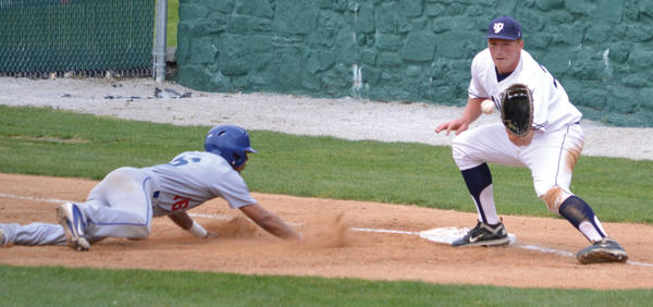 Shepherd University senior first baseman Nathan Minnich, a Waynesboro High School graduate, makes a catch and applies a tag during a college baseball game against Ohio Valley earlier this season. Minnich was honored by the Hagerstown Suns on Wednesday, hours after signing a pro contract with the Boston Red Sox.