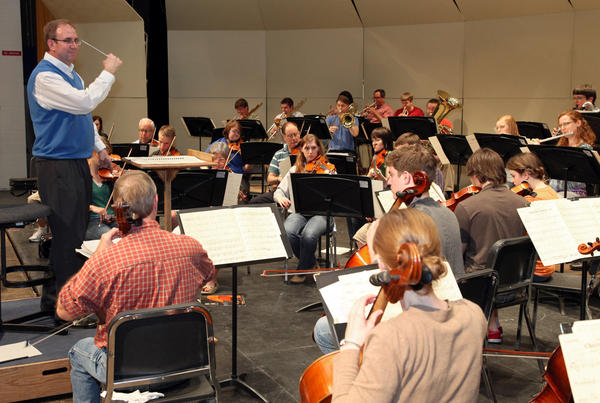 Alan LaFave directs members of the Aberdeen University/Civic Symphony as they rehearsed for an upcoming concert with the rock band Kansas.
