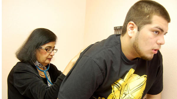 Mario Salazar gets checked by Dr. Vishwa Kapoor. Mario, 17, has both fibromyalgia and rheumatoid arthritis, though on his Tuesday appointment his knees were bothering him.