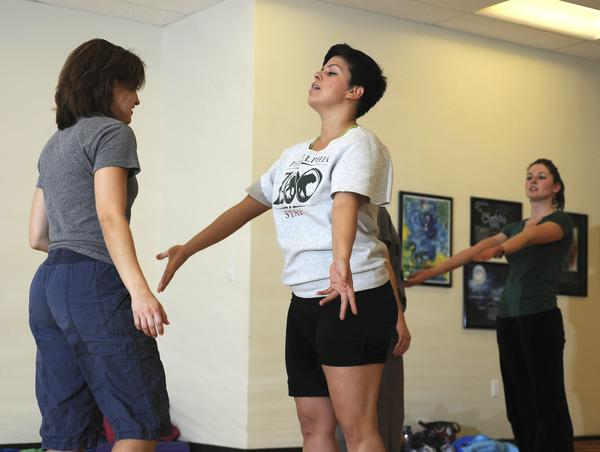 "With a B.A. in dance and psychology, 24-year-old Melissa Talleda (center) keeps busy, dancing and choreographing with Baltimore modern dance company the Collective and teaching preschool children in Bolton Hill life skills such as manners, sharing and respect. She took some time to talk with b in the days preceding the Collective's newest show, a collaborative effort between the dancers, Baltimore band The Water and DJ Relax. <br><br> <b>Favorite style of dance to watch?</b><br>All styles of hip-hop: Breakdancing, Krumping, Voguing ... I wish I could move like that! <br><br> <b>Last great meal you had?</b><br> Sushi at Aloha on Charles Street. It's my absolute favorite place in the city! <br><br> Read more about Melissa <a href=""http://www.baltimoresun.com/entertainment/bthesite/bal-likedislike-melissa-talleda-dancer-and-teacher-20110823,0,6973465.story"">here.</a>"