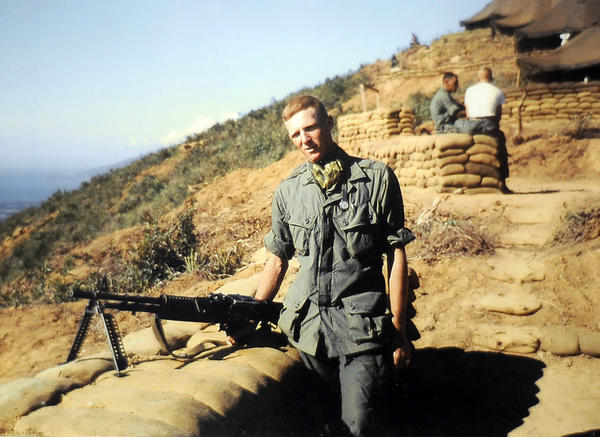 Clark Mayer of Hagerstown poses with his weapon in Vietnam in 1965.
