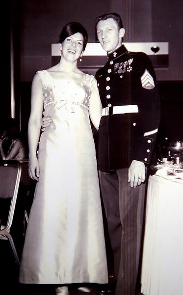 Clark Mayer wears his dress uniform in a picture with his wife, Joan.
