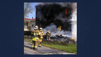 Firefighters battle a blaze at the Jeff and Lisa Richards house in Lavansville Sunday morning.