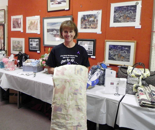 Waynesboro's Gala Cancer Auction Steering Committee Chairwoman Jill Kessler shows off one of the popular auction items - Scotty dog quilt made by the students in Ellen Scott's class at Summitview Elementary School. The item was auctioned at Saturday's 31st annual Waynesboro Area Gala Cancer Auction at the Eagles Club on E. Main Street in Waynesboro.