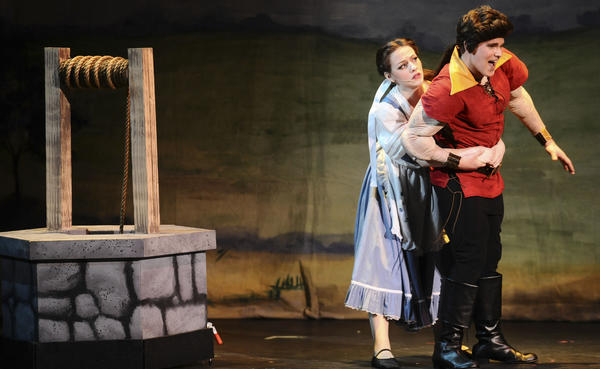 "Julia Thompson as Belle and Ryan Smetzer as Gaston perform Sunday during Barbara Ingram School for the Arts' production of ""Beauty and the Beast"" at the Maryland Theatre in downtown Hagerstown."