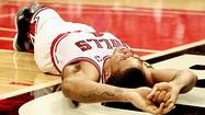Amid the civic uncertainty Saturday night over Derrick Rose's basketball future created by the torn ACL in his left knee came hope from the unlikeliest of places: on a mound inside a baseball park six miles south.