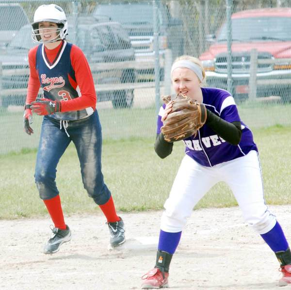 Paige Hornbeck (left) of Boyne City gets set to lead off from third base during a game with Gladstone Saturday in the Boyne Softball Invitational.