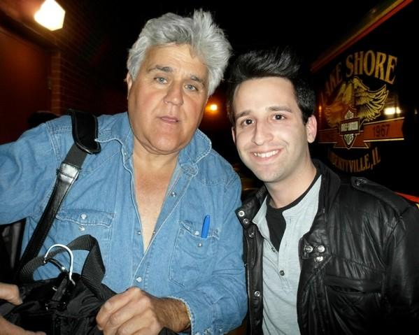 """Tonight Show"" host Jay Leno poses for a photo with a fan outside of the Cadillac Palace Theatre April 28, 2012."