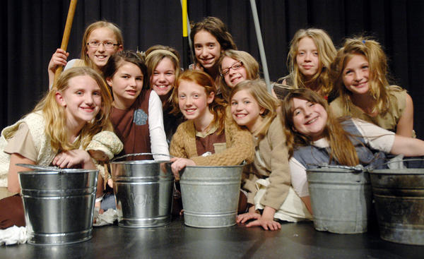 "Orphans in the Boyne City Middle School Drama Department's production of ""Annie Jr."" are (from left) Kathryn Zucker, Eleri Giem, Molly Burch, Rhianna Furness, Kendra Kruzel, Katie McHugh, Aurianna Leismer, Natalie Snyder, Emily Mansfield, Emma Jason and Katie Burley."